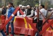 "People standing behind barricades at Delhi Chief Minister Arvind Kejriwal's ""Janata Darbar"""