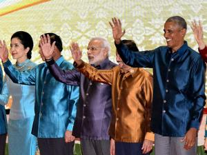Narendra Modi with other leaders waves at the Gala Dinner