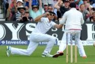 England's Alastair Cook celebrates after catching Australia's Chris Rogers