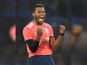England bowler Chris Jordan celebrates the wicket of Indian batsman Virat Kohli