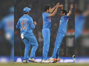 Indian bowler Ashish Nehra celebrates after taking wicket of England batsman Jason Roy