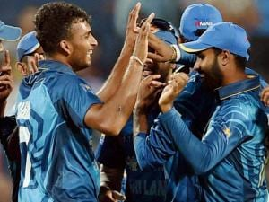 Sri Lankan bowler Dasun Shanaka celebrates the wicket of Indian batsman Hardik Pandya during the first T20 match in Pune
