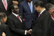 Chinese President Xi Jinping greets Zimbabwean President Robert Mugabe