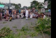 Members of various organizations protesting at the National Highway 39 at Telgaram  in Golaghat