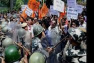 Security personnel try to stop activists of Akhil Bharatiya Vidyarthi Parishad (ABVP) during the 12 hour Assam bandh in Guwahati