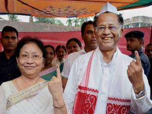 Assam Chief Minister Tarun Gogoi with his wife Dolly Gogoi showing their mark after casting vote for the first phase of Assam Assembly election, at Jorhat district of Assam
