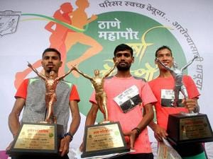 Winners pose with their trophies at the 27th annual Thane Monsoon Marathon in Thane