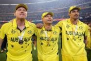 Australia's James Faulkner, left, walks his captain Michael Clarke and Mitchell Johnson