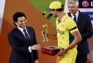 Former Indian cricketer Sachin Tendulkar, left, presents the player of the tournament trophy to Australia's Mitchell Starc