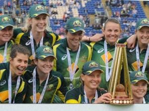 Australia captain Meg Lanning holds the trophy as Australia players celebrates winning the Women's Ashes series