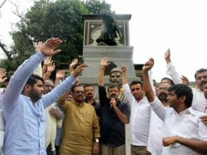 NCP workers stage a protest against giving an award to historian Babasaheb Purandare