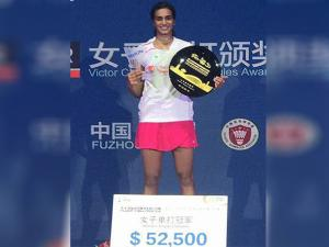 Pusarla Venkata Sindhu poses with trophy  after defeating China's Sun Yu during the final of women's singles in the badminton China Open