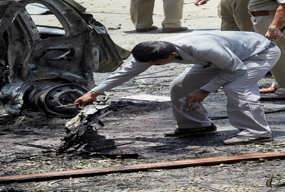 An expert inspects at the site of the blast near the BJP office at Malleswaram in Bengaluru