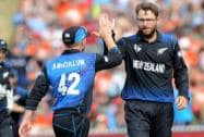 New Zealand's Dan Vettori, is congratulated by his captain Brendon McCullum