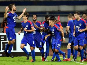 Bengaluru FC Captain Sunil Chhetri and Johor Darul TA'ZIM (MAS) players in action during the AFC Cup 2016 Knock out match at Kanteerava Stadium