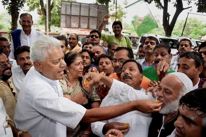 Rashtriya Janata Dal, supporters, celebrate, sweets, declaration, Bihar bypoll results