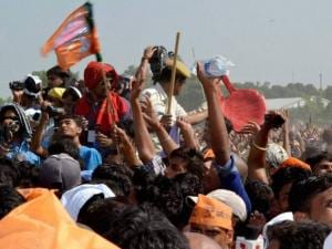 Police control crowd of BJP supporters during election rally