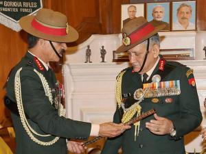 General Dalbir Singh handing over the baton to General Bipin Rawat in the office of Chief of Army Staff