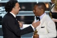 "Eddie Murphy, right, presents Alejandro G. Inarritu with the award for the best original screenplay for ""Birdman"""