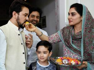 BCCI president Anurag Thakur being greeted by his wife at his residence in New Delhi
