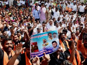 Karnataka BJP President B S Yeddyurappa and Member of Parliament Shobha Karandlaje along with party workers protest against the Congress government for celebrating Tipu Jayanti