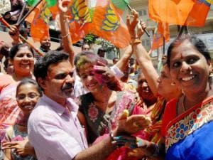 BJP workers celebrate the party's victory in BBMP