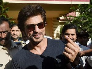 Shahrukh Khan showing his ink marked finger after casting the vote for the Municipal Corporation election in Mumbai