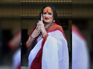 Transgender rights activist Laxmi Tripathi showing indelible ink marked finger after casting votes