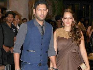 Cricketer Yuvraj Singh with fiance Hazel Keech at the wedding reception of Preity Zinta and Gene Goodenough, in Mumbai