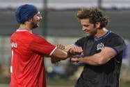 Bollywood actors Hritik Roshan and Dino Morea during a charity football match in Mumbai