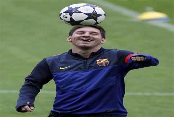 Barcelona's Lionel Messi laughs during a training session in Munich
