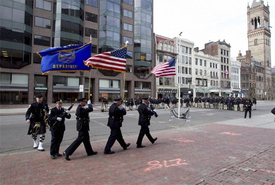 Officers march into position near the blast site on Boylston Street