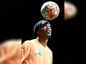 footballer Ronaldinho tries a newly developed ballgame called teqball during its official presentation in Budapest
