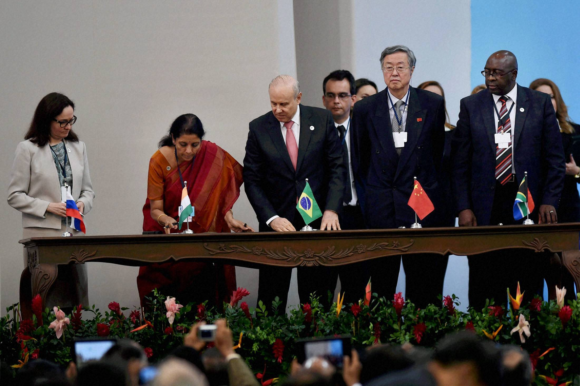 Minister of State, Finance, Corporate, Affairs Nirmala Sitharaman, signing, agreement, creation, development,  bank, 6th BRICS summit, Fortaleza, Brazil