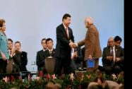 Prime Minister Narendra Modi shakes hands with Chinese President Xi Jinping as the Brazilian President Dilma Rousseff, left, looks on during the signing ceremony of 6th BRICS summit