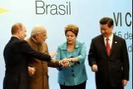 Prime Minister Narendra Modi join hands with Brazil's President Dilma Roussef