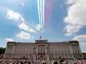 The Red Arrows fly past as Britain's Royals watch from the balcony of Buckingham Palace