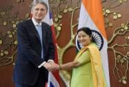 External Affairs Minister Sushma Swaraj shakes hands with British Foreign Secretary Philip Hammond