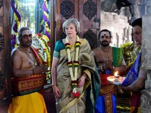 Theresa May, donning a saari, visits the Someshwara temple along with the priests in Bengaluru