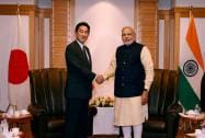 Prime Minister Narendra Modi shakes hands with Minister of Foreign Affairs Fumio Kishida at a meeting