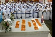 Nuns of the Missionaries of Charity paying their respect at Mother Teresa's tomb