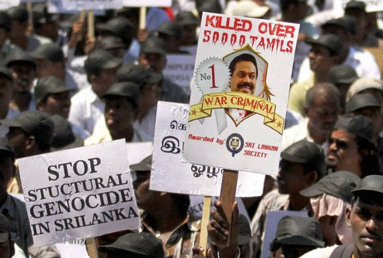 Tamilians participate in a rally to protest against alleged war crimes