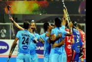 India's captain Sardar Singh, celebrate with teammate after scoring a goal
