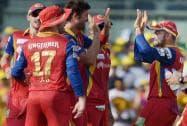 Royal Challengers Bangalore's player David Wiese celebrating with teammates the wicket of Chennai Super Kings' Brendon McCullum