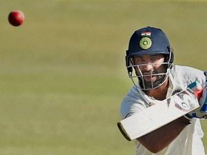 Cheteshwar Pujara plays a shot on the third day of the first Test match against England