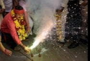 BJP MP Manoj Tiwari burns crackers as he celebrates with Purvanchalis after declaration of Chhath puja as a public holiday in Delhi