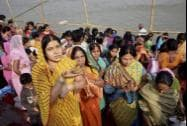 Women worship at the banks of Ganga river on the occasion of the four days long Chhath festival