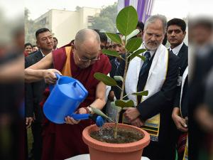 Dalai Lama with  Delhi Lt. Governor Najeeb Jung planting a tree at the 5th Annual Convocation of Ambedkar University