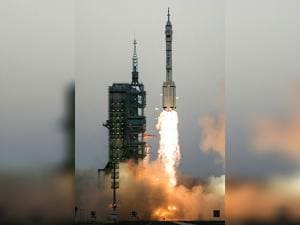 China's Shenzhou 11 spaceship onboard a Long March-2F carrier rocket takes off from the Jiuquan Satellite Launch Center