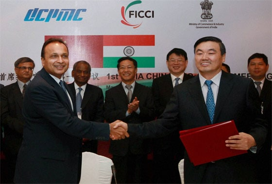 Reliance ADAG Chairman and Co-chair (Indian side) Anil Ambani shakes hands with Hu Huaibang, Co-Chair, Chinese side, after signing an agreement during the 1st Meeting of India China CEOs Forum in New Delhi